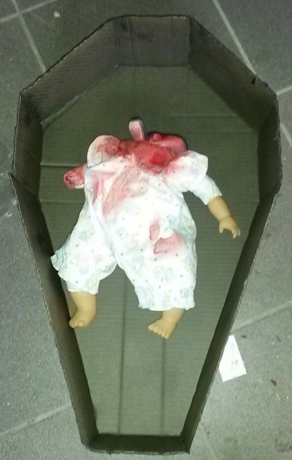 Beheaded doll
